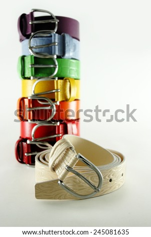 Belts of different colors with round buckle