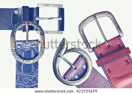 Belts with buckle unit. Toned colors vintage image - stock photo