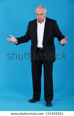 Bemused senior businessman - stock photo