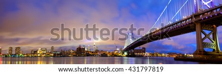 Ben Franklin Bridge and Philadelphia skyline panorama at dusk, US