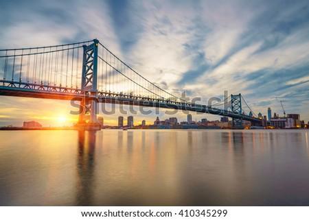 Ben Franklin Bridge in Philadelphia at sunset. - stock photo