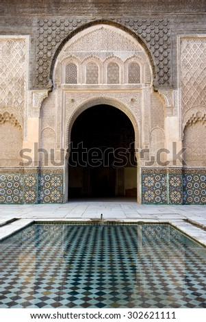 BEN YOUSSEDD MEDERSA, MARRAKESH, MOROCCO - JULY 2010: The Ben Youssef Madrasa was an Islamic college in Marrakesh, Morocco - stock photo