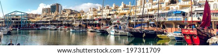 "BENALMADENA, SPAIN - DEC 19 2013:Day view of Puerto Marina, that has won the title of ""Best Marina in the World"" several times. It has a very unusual and modern architecture on 19 december, 2013 - stock photo"