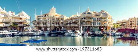 "BENALMADENA, SPAIN - DEC-19 December, 2013:View of Puerto Marina, that has won the title of ""Best Marina in the World"" several times. It has a very unusual and modern architecture on 19 december, 2013 - stock photo"