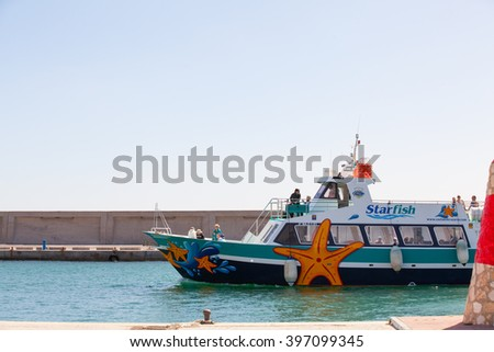 BENALMADENA, SPAIN - MARCH 5, 2016: Touristic boat entering to Puerto Marina Harbor, in Benalmadena (Spain). Puerto Marina is one of the biggest ports in Andalusia, and is located at Costa del Sol.  - stock photo