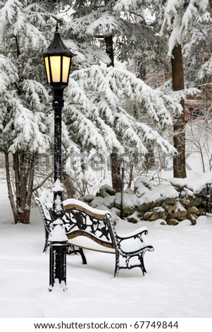 bench and streetlight in snow - stock photo