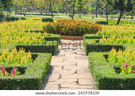 Bench and walkway in the garden of Suan Luang Rama 9 public park - stock photo