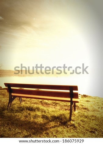 bench at a lake (84) in upper bavaria with mountains in background
