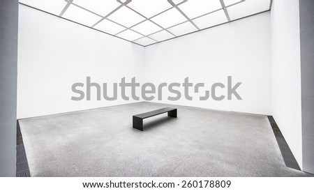 bench at an empty gallery in berlin - nice background - stock photo