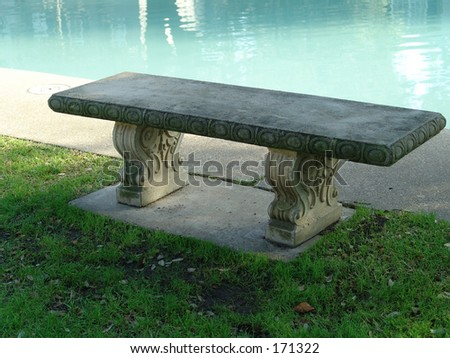 bench at poolside - stock photo