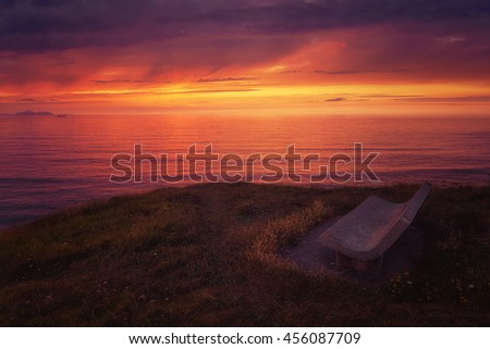 bench at the sunset near the sea
