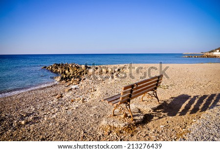 Bench by Aegean Sea. Samos, Greece - stock photo