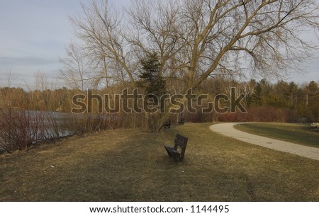 Bench by water - stock photo