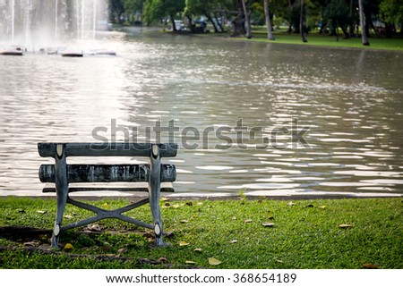 bench, chair beside river in the nature park - stock photo