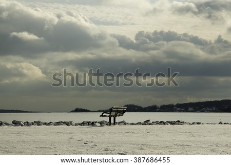 Bench commands view of Narragansett Bay under heavy clouds - stock photo