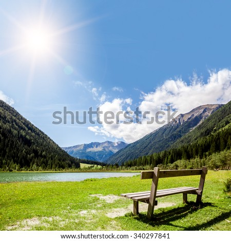bench for relaxing with a view on the Alps in Austria - stock photo