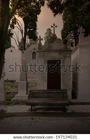 Bench from a cemetery at twilight - stock photo
