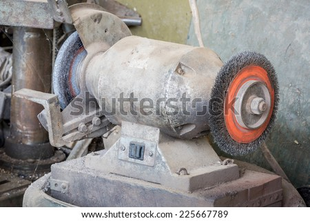 Bench Grinder in factory. - stock photo