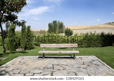 Bench in a green park - stock photo