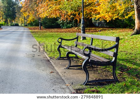 Bench in a park. - stock photo