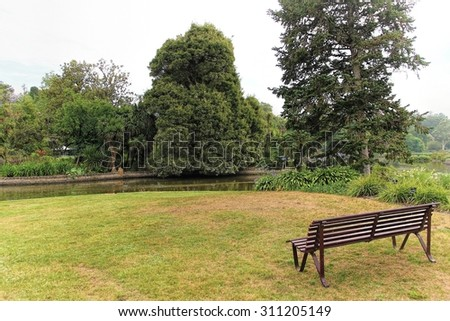 Bench in a public park of Royal Botanic Gardens Melbourne - stock photo