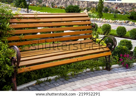 Bench in city park in the autumn  - stock photo