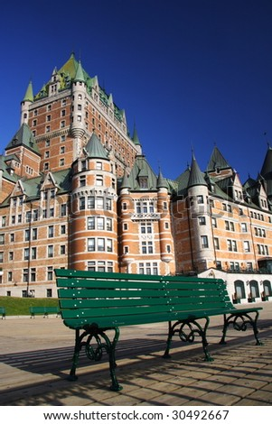 Bench in front of Chateau Frontenac, Quebec City. - stock photo