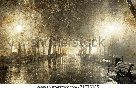 Bench in night alley with lights in Odessa, Ukraine. Photo in old image style. - stock photo