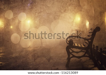 Bench in night alley with lights in Odessa, Ukraine. Photo in retro style. - stock photo