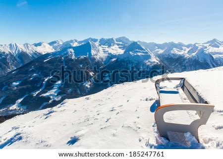 Bench in ski resort Bad Gastein in winter snowy mountains, Austria, Land Salzburg,  Austrian alps - nature and sport background - stock photo