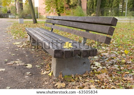 bench in the city park - stock photo