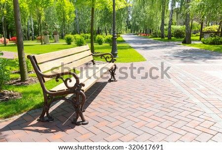 Bench in the local park - stock photo