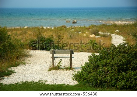 Bench in the sand on Lake Michigan USA