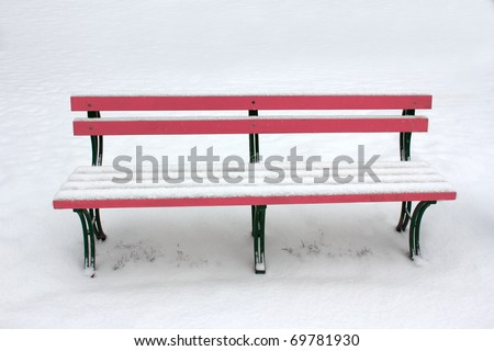 bench in the snow - stock photo
