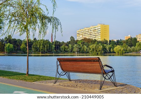 Bench in Titan / IOR park in a summer afternoon in Bucharest, Romania - stock photo