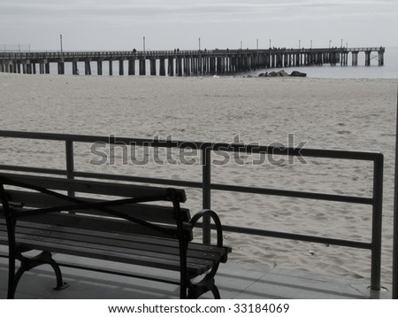 bench looking out on Brighton Beach and the pier of Coney Island - stock photo