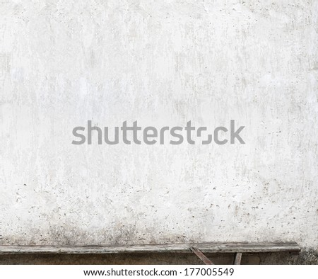 bench near the wall background - stock photo