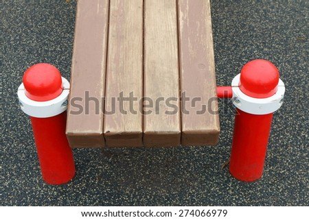 Bench of an outdoor children sport complex in the court playground - stock photo