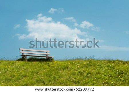 Bench on sky background. Tranquil scene. - stock photo