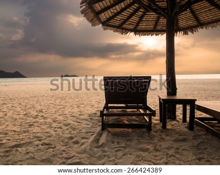 Bench on the beach overlooking the sea