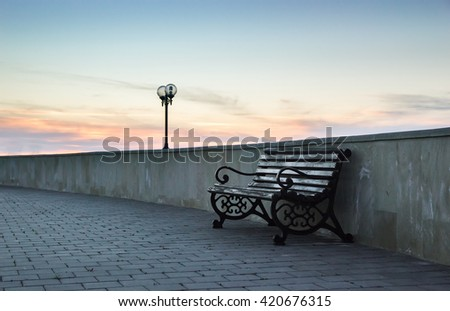 Bench on the sidewalk - stock photo