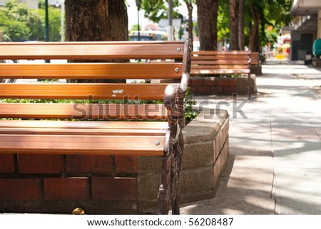 bench on the sidewalk in the street,outdoor bench for sit public - stock photo