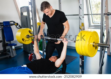 Bench Press Workout With Personal Trainer. - stock photo
