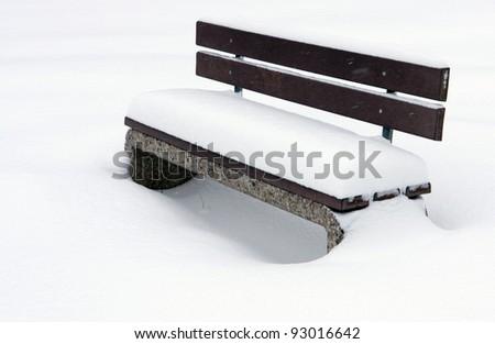 bench under snow winter park - stock photo
