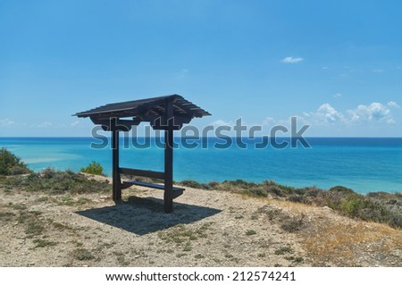 bench with roof on top of hill - stock photo