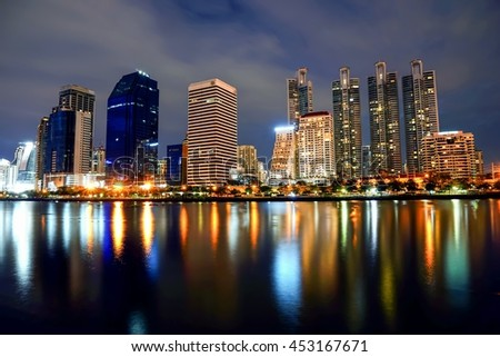 Benchakitti Park Bangkok City Thailand At Night And Reflection In Water And Vivid Color And Light Effects