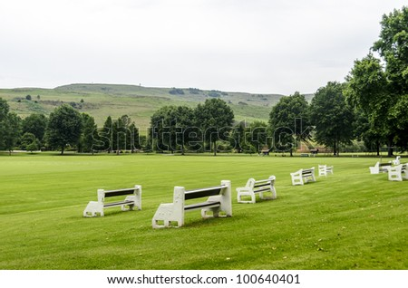 Benches at the cricket field of Michael House in KZN - stock photo
