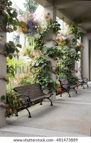 Benches at the outside hallway of the Empress Hotel in Victoria, Canada