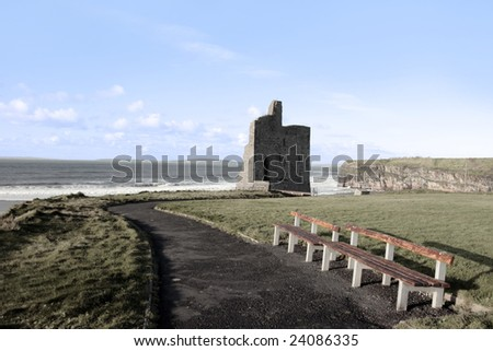benches beside a castle in ballybunion county kerry ireland - stock photo
