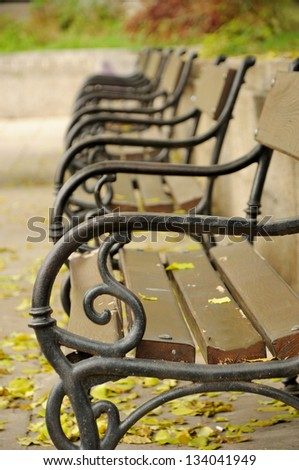 benches in the city park - stock photo